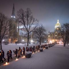 Students and staff walk out of the Main Building after a midnight prayer service in honor of the Rev. Martin Luther King Jr. holiday.
