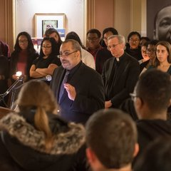 First Year of Studies Dean Rev. Hugh Page speaks at a candlelight prayer service in the Main Building in observation of Martin Luther King Jr. Day.